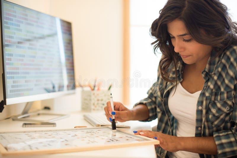 Woman writing on calendar stock photo