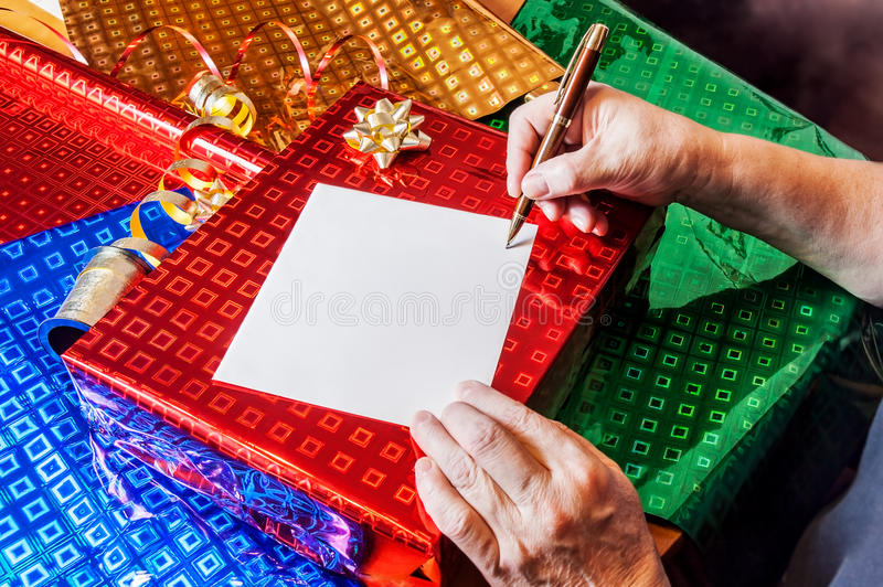 Woman writing card. Gift present concept. Woman writing greeting card. Gift present concept stock photos