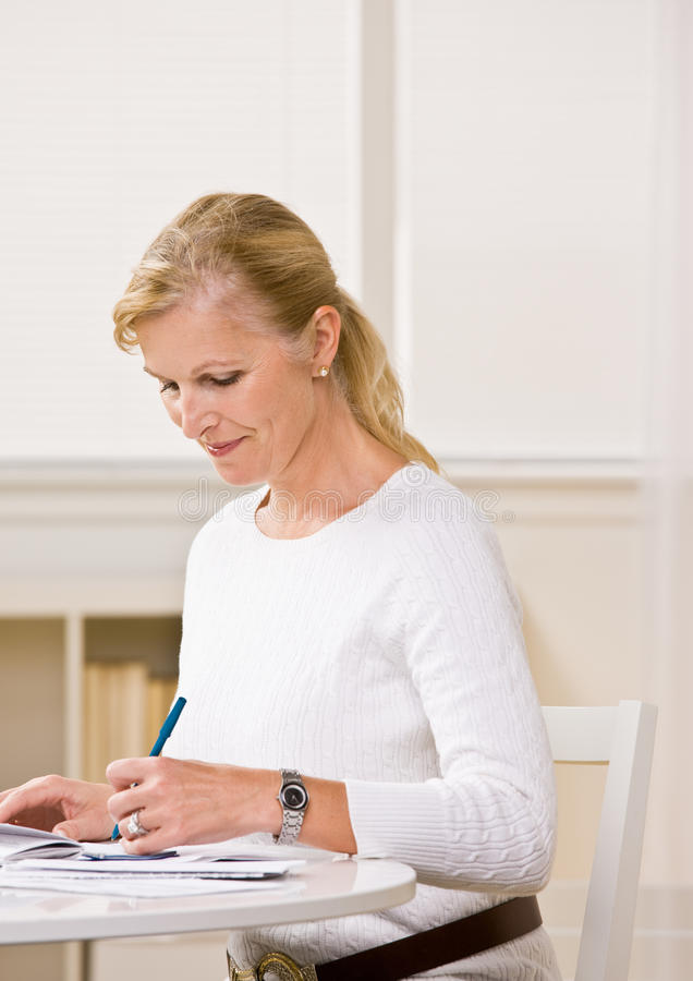 Download Woman writing checks stock image. Image of monthly, aged - 17049627