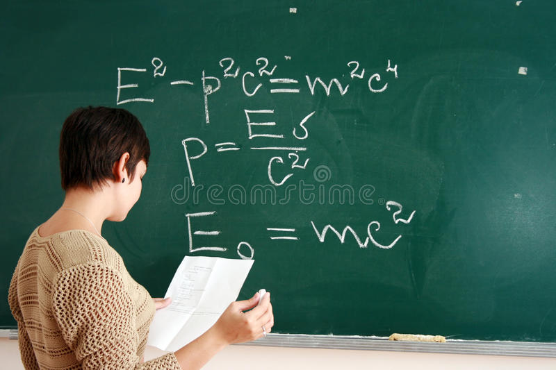 Woman Writing Formula Royalty Free Stock Photos