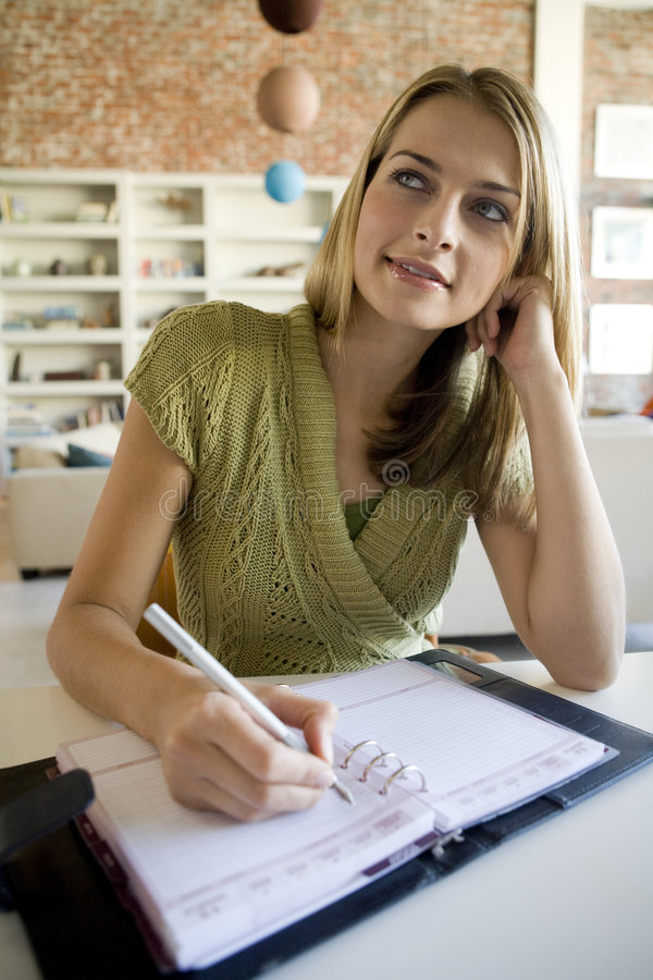 Download A Woman Writing In Her Agenda Stock Photo - Image: 3313794