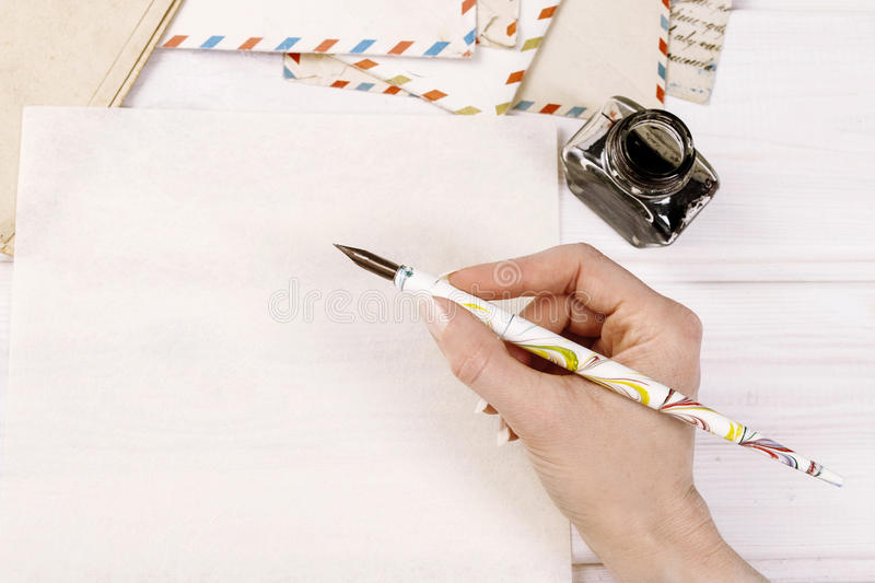 Woman writing a letter. Copy space stock photography