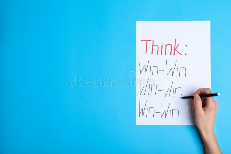 Woman writing motivational inscriptions, top view with space for text royalty free stock photos