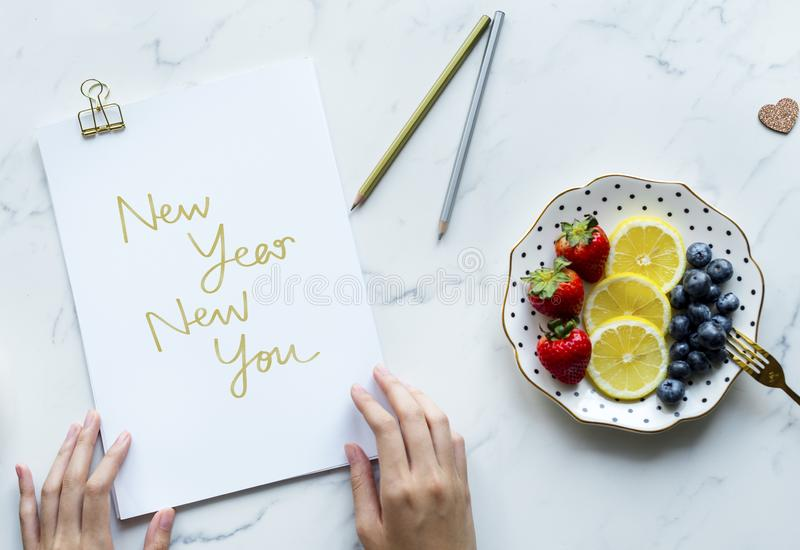 Woman writing New Year New You royalty free stock photography