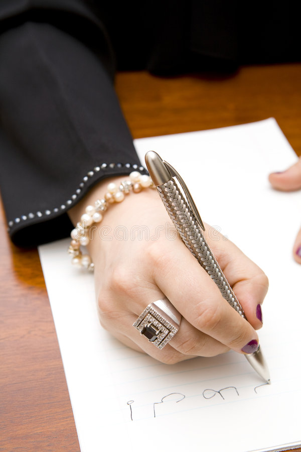 Woman writing note in Arabic stock photos