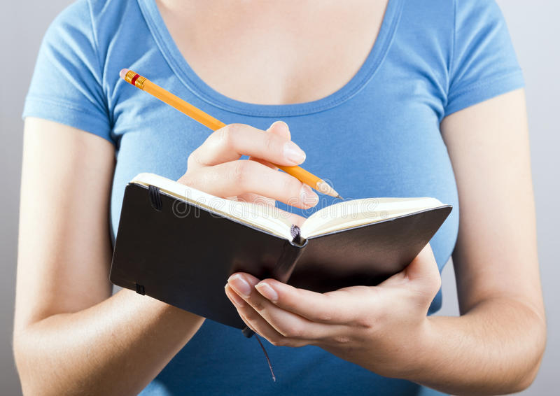 Woman Writing In Notebook royalty free stock images