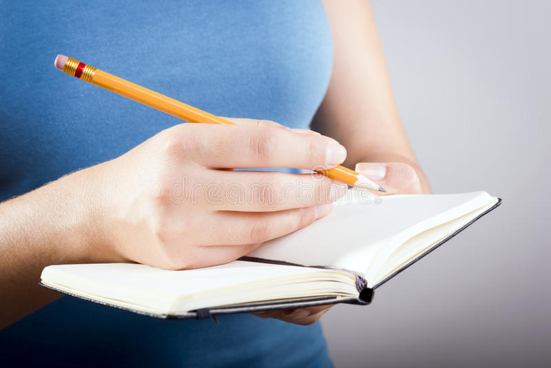 Download Woman Writing In Notebook stock image. Image of pencil - 31140737