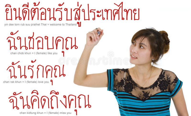 Woman writing with a red marker. Beautiful young asian woman writing thai sentences or whatever you want with a red marker, isolated on white background stock photography