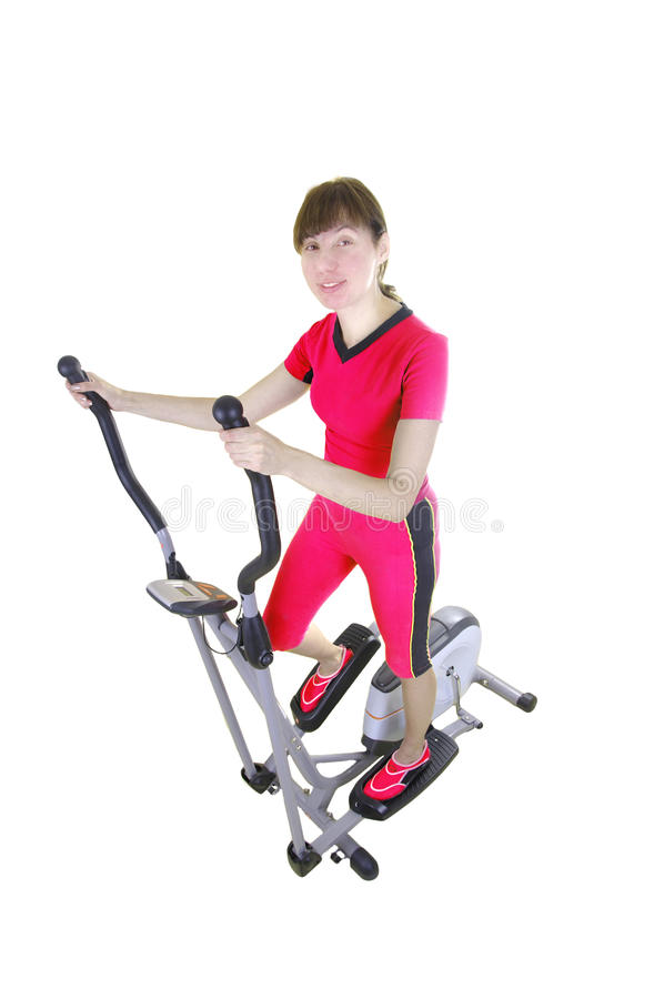 Woman and xtrainer machine stock photos