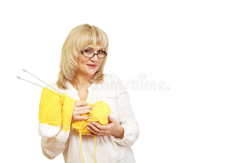 Woman with yarn and knitting royalty free stock photography