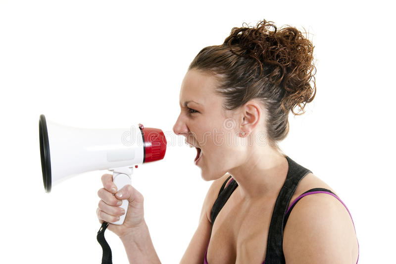 Woman yelling into a bullhorn. Attractive Caucasian woman yelling into a bullhorn stock image
