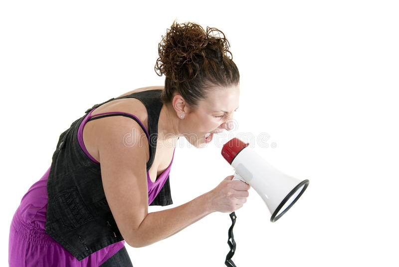 Woman yelling into a bullhorn. Attractive Caucasian woman yelling into a bullhorn royalty free stock images