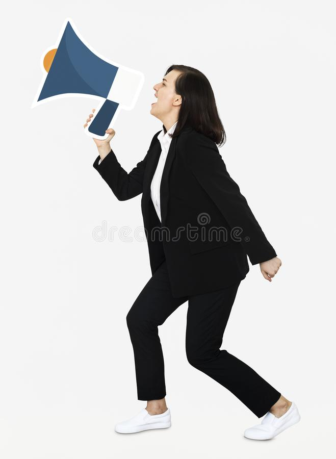 Woman yelling into a megaphone stock photo
