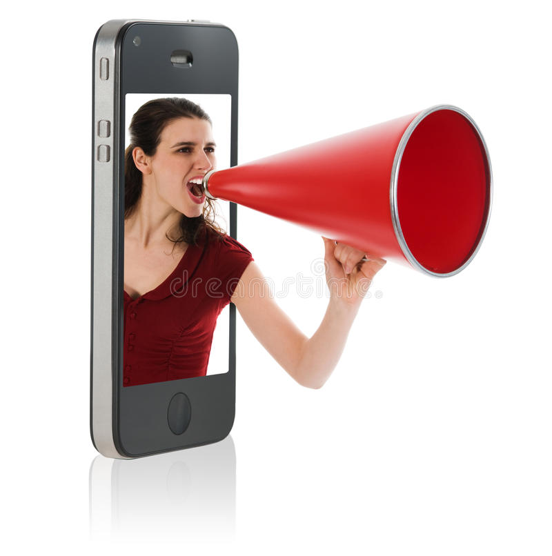 Woman yelling in megaphone stock photo