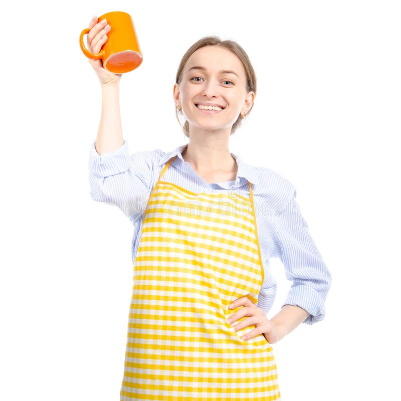 Woman in yellow apron orange cup in hand royalty free stock images