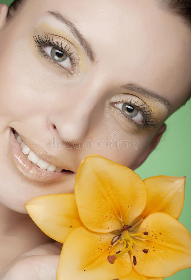 Woman with yellow flowers on green background royalty free stock photo