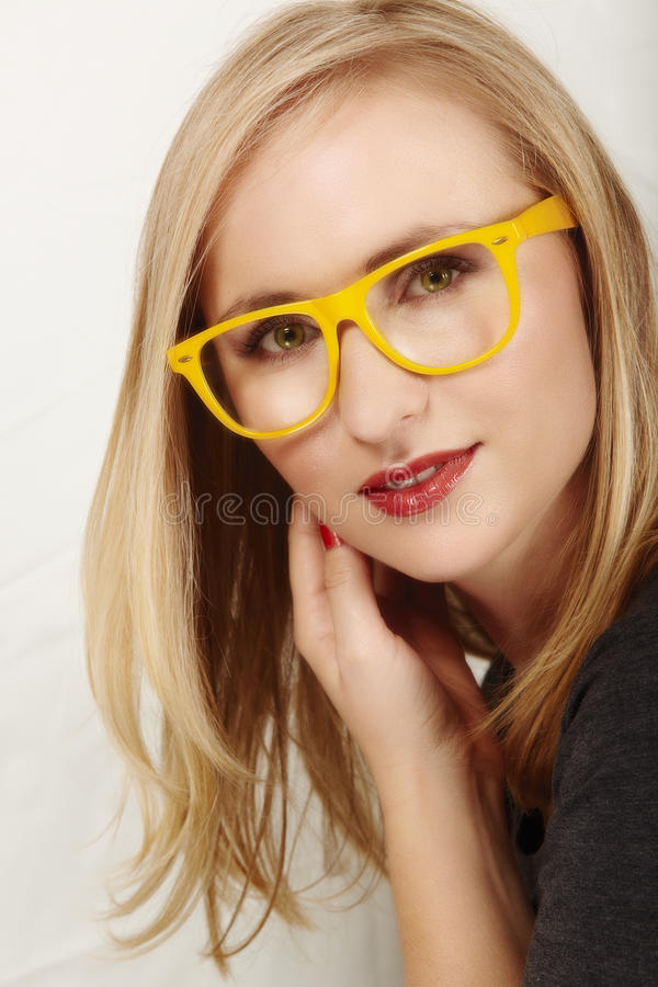 Woman with yellow glasses. stock images