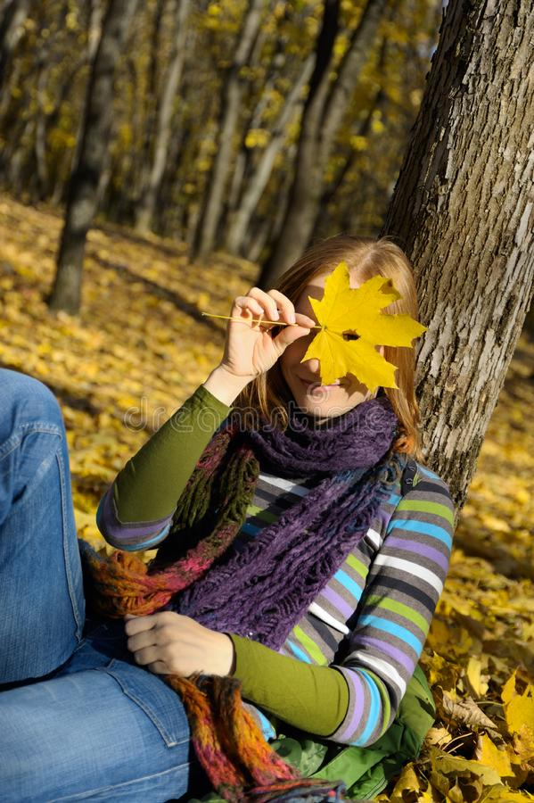 Woman and a yellow leaf stock image