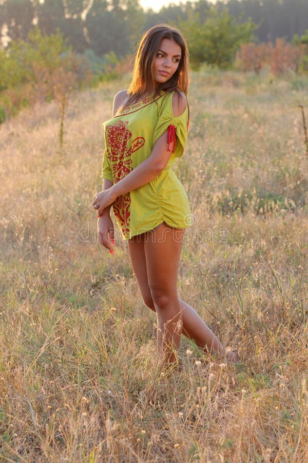 Woman In Yellow Red Floral One Shoulder Shirt Standing On Brown Grass During Daytime Free Public Domain Cc0 Image