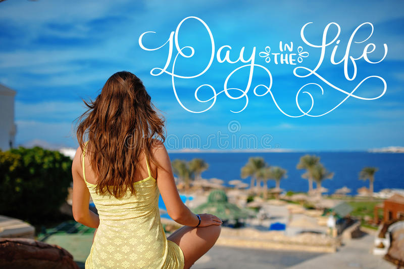 Woman in yellow sundress looks at the sea and text Day in the life. Calligraphy lettering vintage hand draw stock images
