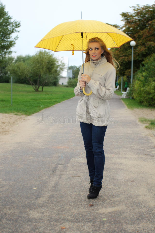 Download Woman With Yellow Umbrella In The Park Stock Photo - Image: 21723318