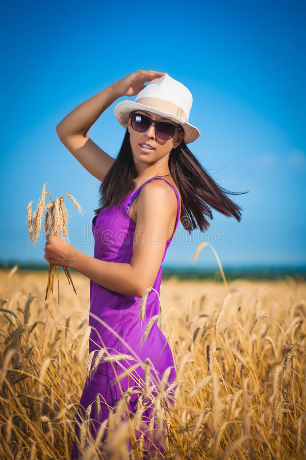 Woman on the yellow wheat field royalty free stock photo