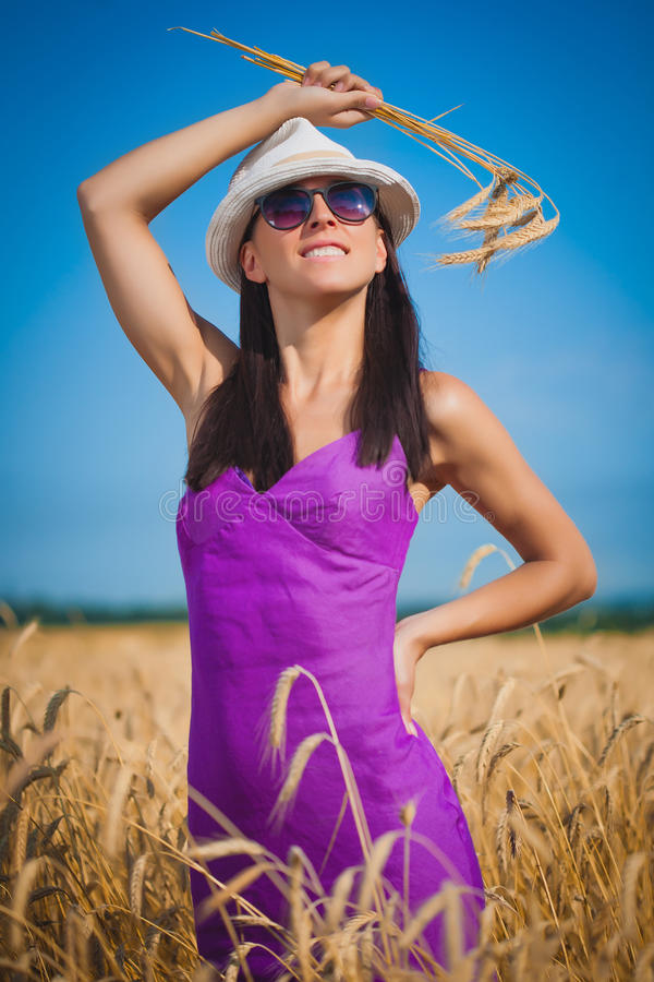 Woman on the yellow wheat field royalty free stock photography