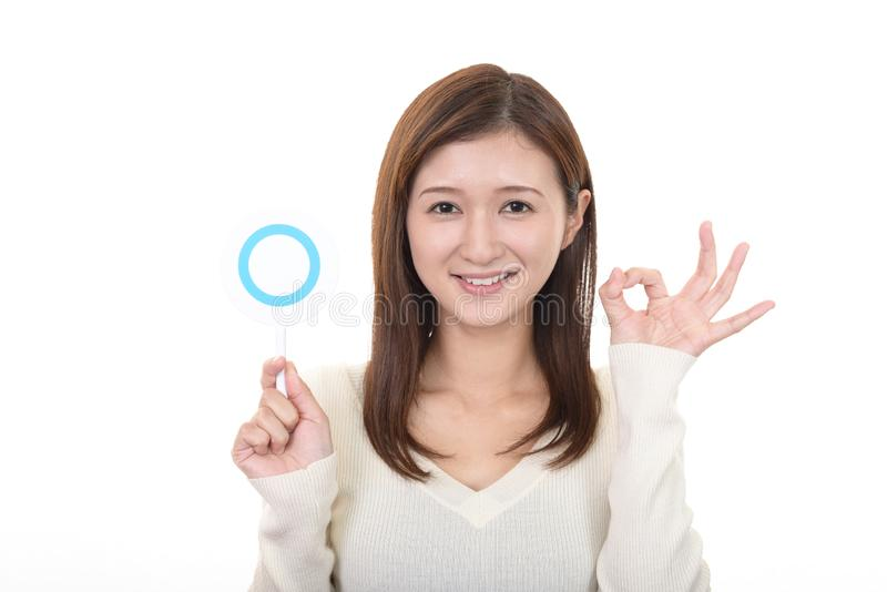 Woman with a Yes sign stock photography