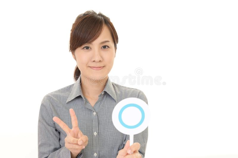 Woman with a Yes sign stock image