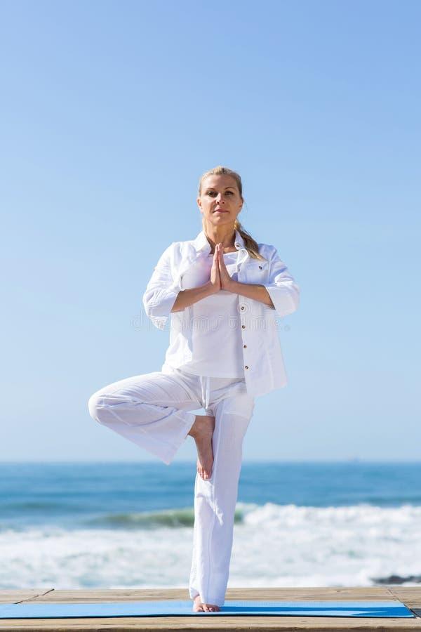 Woman yoga exercise stock photos