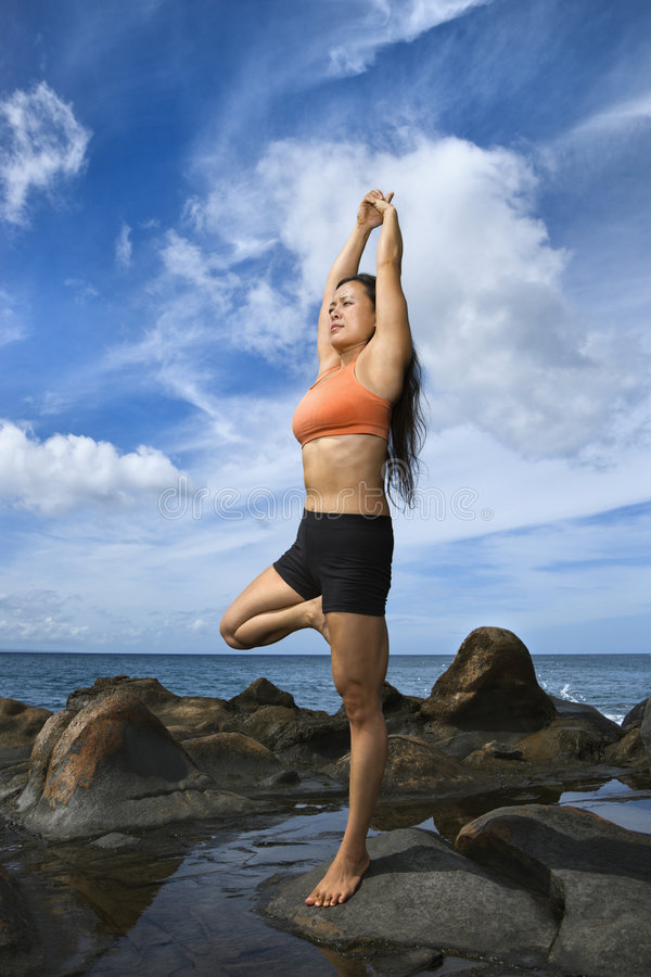 Woman in yoga pose stock image