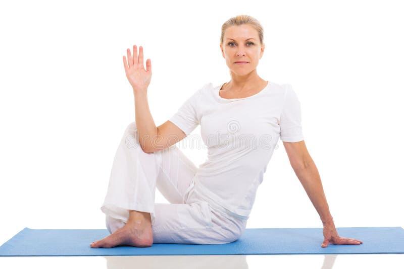 Woman yoga pose. Beautiful middle aged woman yoga pose on white background royalty free stock photo