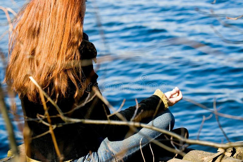Woman at yoga pose at the lake royalty free stock photography