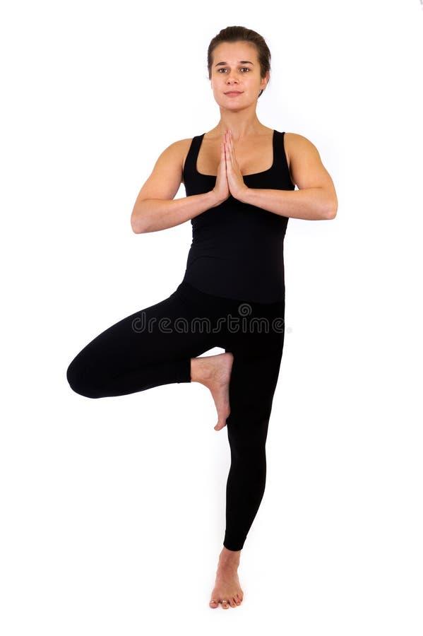 Woman in yoga pose on white royalty free stock photos