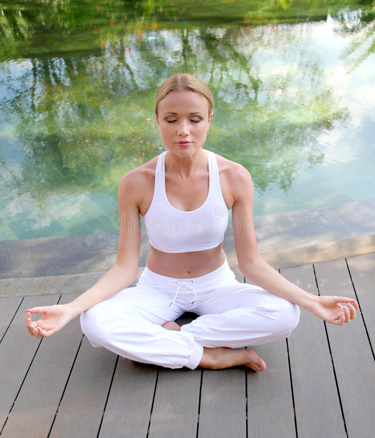 Woman in yoga position stock images