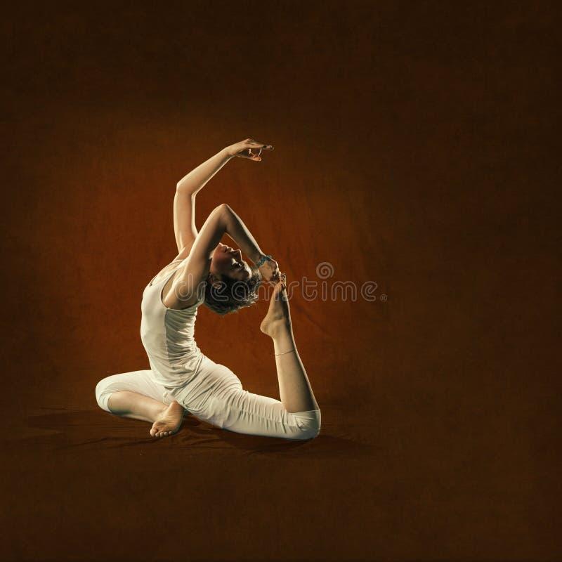 Woman in yoga position. Raja Kapota. Attractive young woman in yoga position.Raja Kapota royalty free stock images