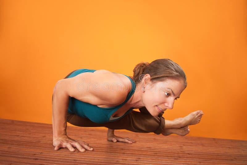 Woman In Yoga Posture stock image