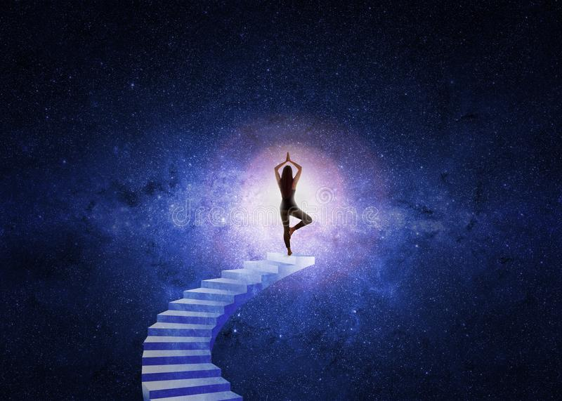 Woman yoga stairs to the universe royalty free stock photos