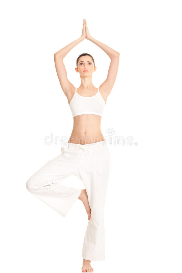 Woman In Yoga Tree-pose Stock Images