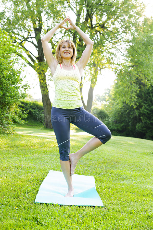 Download Woman in yoga tree pose stock photo. Image of green, exercise - 32020712