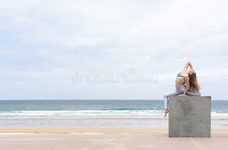 Woman yogi doing the pigeon pose royalty free stock images