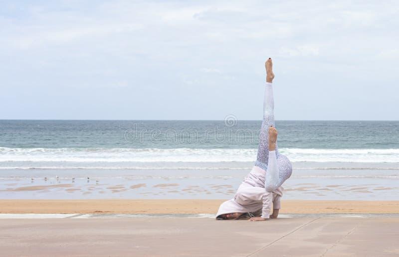 Woman yogi doing a pose stock photos
