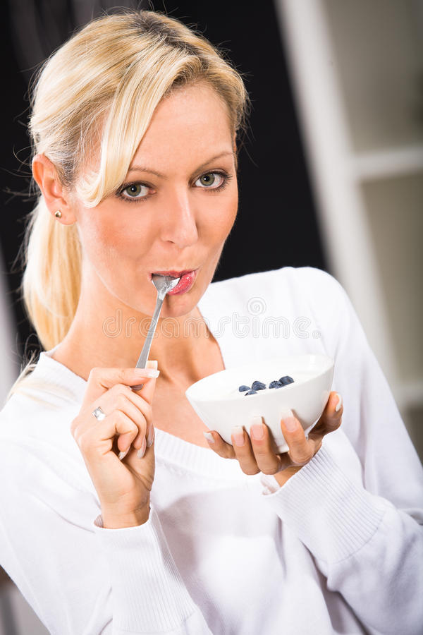 Woman with yogurt bowl royalty free stock image