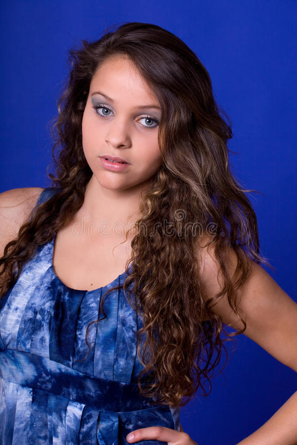 Woman. Young beautiful woman, on a blue background stock photo