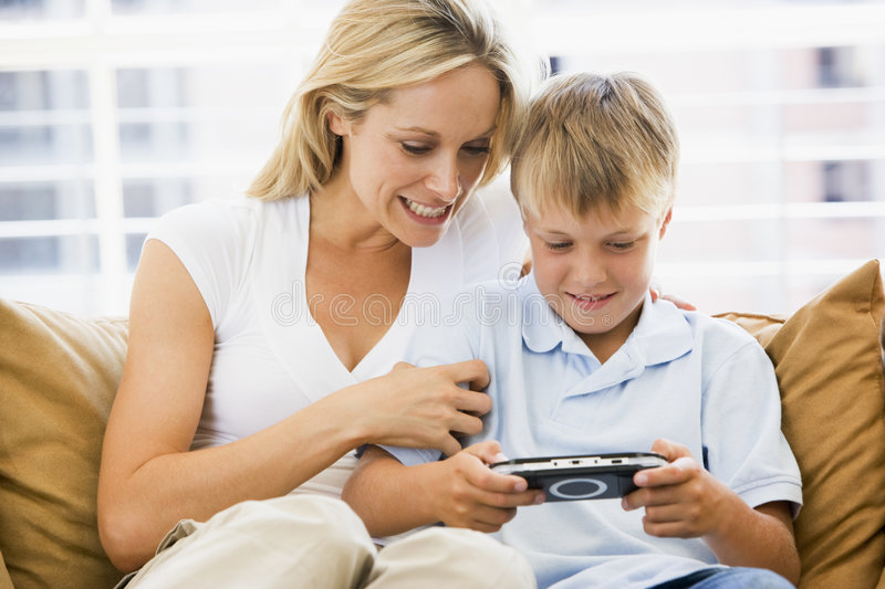 Download Woman And Young Boy In Living Room Stock Photo - Image: 5930832