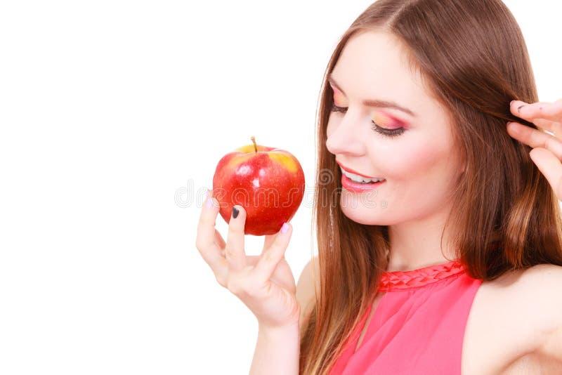 Woman charming girl colorful makeup holds apple fruit stock image