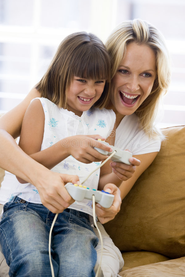 Woman and young girl in living room royalty free stock images