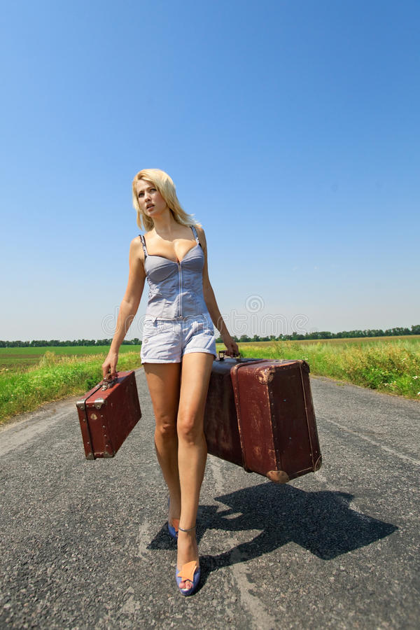 Download Womanl with her baggage stock image. Image of freeway - 20725355
