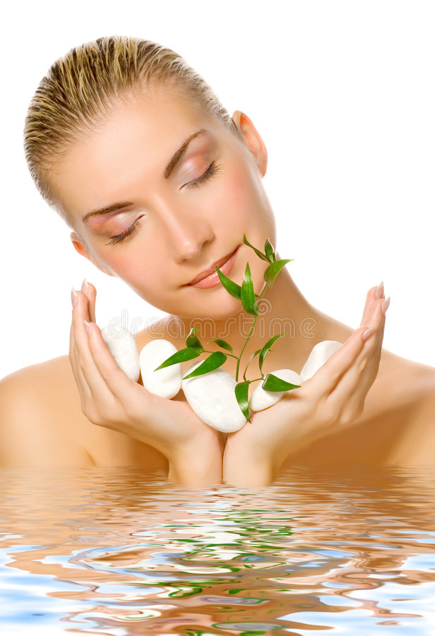 Womanl holding young plant stock image