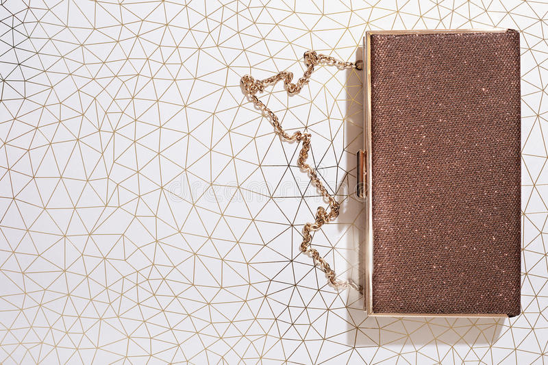 Womans clutch purse bag on shiny background, top view, celebration, royalty free stock photo